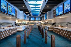Um restaurante ou outro lugar para comer em Universal's Endless Summer Resort - Surfside Inn and Suites