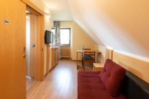 Ein Sitzbereich in der Unterkunft Avenon Privathotel Schwaiger Hof