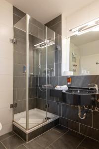 Ein Badezimmer in der Unterkunft Avenon Privathotel Schwaiger Hof