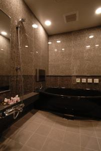 A bathroom at AROMA KURAVI (Adult Only)