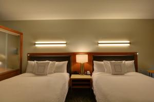 A bed or beds in a room at SpringHill Suites Denver at Anschutz Medical Campus