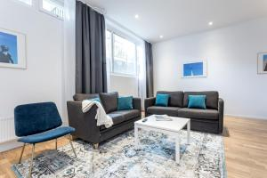 A seating area at ApartDirect Sundbyberg