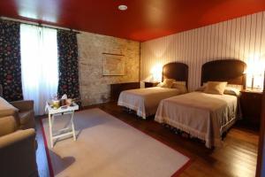 A bed or beds in a room at Pazo La Buzaca