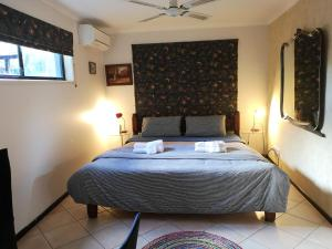 A bed or beds in a room at Noosa Edge Nudist Retreat