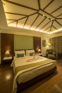 A bed or beds in a room at The Lagoona Resort