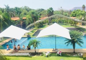 Vista de la piscina de Hotel Posada El Encanto o alrededores