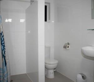 Um banheiro em Villa Porto Marie