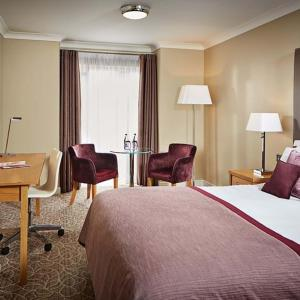 A bed or beds in a room at Lion Quays Resort