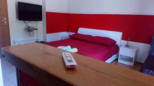 A bed or beds in a room at Studio & Rooms