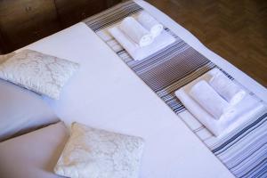 A bed or beds in a room at Appartamento I Giardini del Teatro