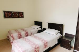 A bed or beds in a room at Trip.LE Hostel Samarkand