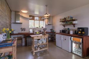 A kitchen or kitchenette at Skyrhúsid Guest House