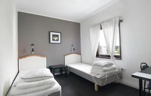 Säng eller sängar i ett rum på Hostel 10
