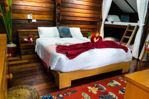 Кровать или кровати в номере Rice Barn And Rooms