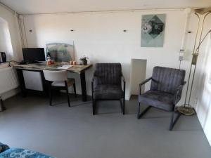Een zitgedeelte bij Bed & Breakfast Fort Bakkerskil