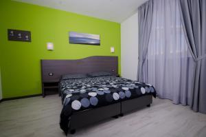 Letto o letti in una camera di Hotel Rainbow Resort