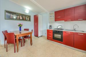 A kitchen or kitchenette at VILLA GARUTI VILLAGE
