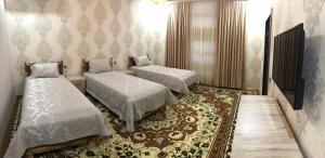 Cama ou camas em um quarto em Qaynama
