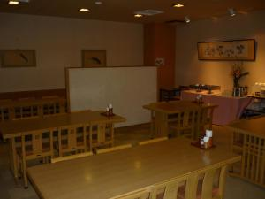 A restaurant or other place to eat at Takada Terminal Hotel