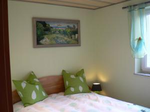 A bed or beds in a room at Gite de la Lisière du Bois