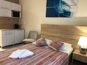 Кровать или кровати в номере Гостиничный комплекс Светогорск