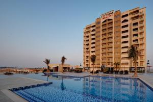 The swimming pool at or near City Stay Beach Hotel Apartments - Marjan Island
