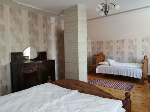 A bed or beds in a room at Majoru Promenāde