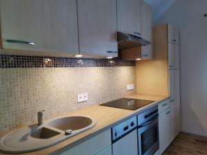 A kitchen or kitchenette at Majoru Promenāde
