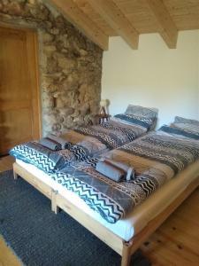 A bed or beds in a room at Ti' Ladeira