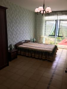 Кровать или кровати в номере Apartment Kurortnyy 108/16