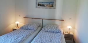 Ein Bett oder Betten in einem Zimmer der Unterkunft Ferienhaus Apfelblüte
