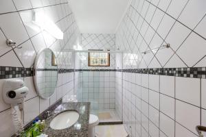 A bathroom at Recanto da Praia