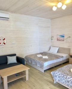 Кровать или кровати в номере Гостевой дом Биг Фиш
