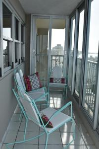 A balcony or terrace at Water Front VIP Condo with Central Air and Parking