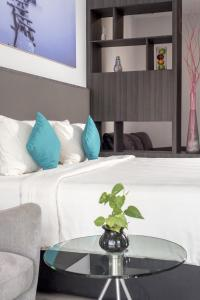 A bed or beds in a room at The Hills Batam