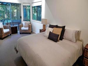 A bed or beds in a room at On the Beach @ Fingal Bay