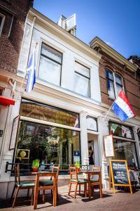 Een restaurant of ander eetgelegenheid bij De Vliegende Vos het geboortehuis van Johannes Vermeer