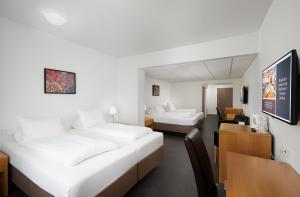 Letto o letti in una camera di Hotel Örk