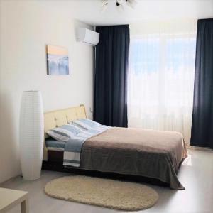A bed or beds in a room at Apartments CITY