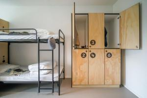 A bunk bed or bunk beds in a room at Via Amsterdam