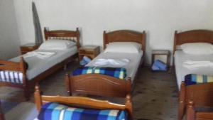 A bed or beds in a room at Guesthouse Dritan Tethorja