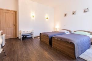 Кровать или кровати в номере Apartment na Voznesenskom 30
