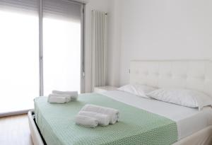Letto o letti in una camera di Housing32 Apartments