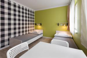A bed or beds in a room at Dizzy Daisy Hostel