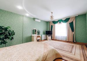 Кровать или кровати в номере Гранд Отель