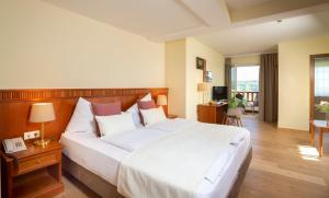 Ein Bett oder Betten in einem Zimmer der Unterkunft Hotel Seppl