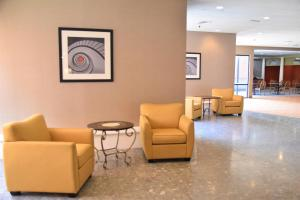 The lobby or reception area at Ramada by Wyndham Wentzville