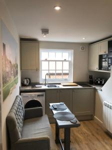 A kitchen or kitchenette at The Lodgings