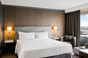 A bed or beds in a room at Radisson Blu Manchester Airport
