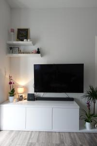 TV a/nebo společenská místnost v ubytování Apartman Maja